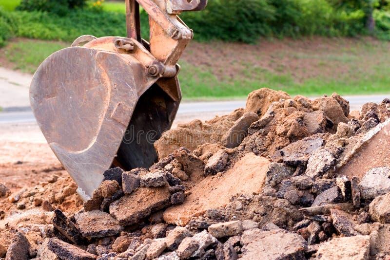 Paletta dell'escavatore a cucchiaia rovescia immagine stock