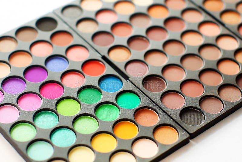 Palette colorée d'ombres d'oeil Composez le fond photographie stock