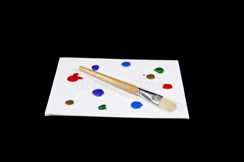 Palette colorée de peinture sur le fond noir d'isolement photos libres de droits