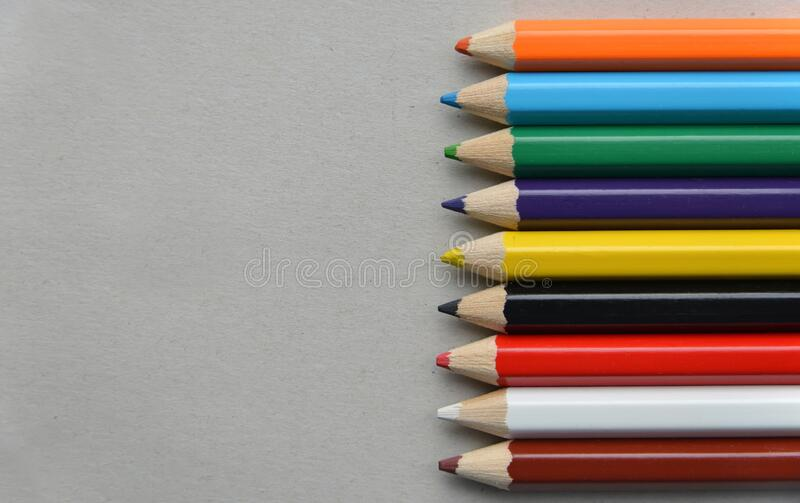 Palette of colored pencils on cardboard stock photos