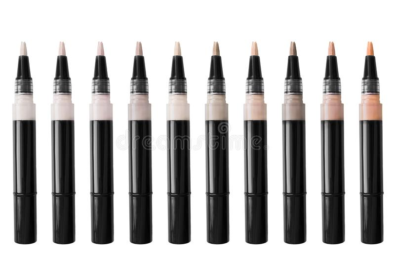 Palette of concealer. Palette of liquid concealer sticks on white background royalty free stock photo