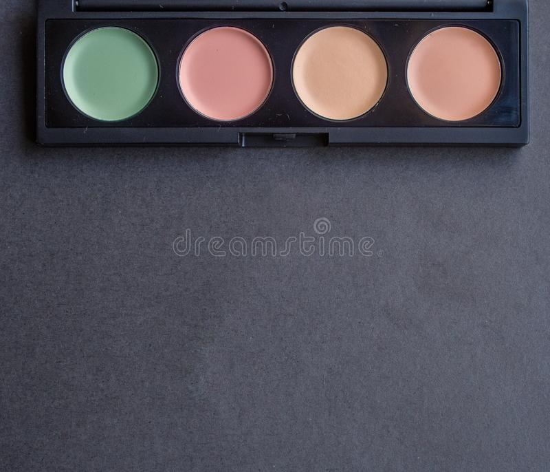 Palette with different makeup correctors stock photography