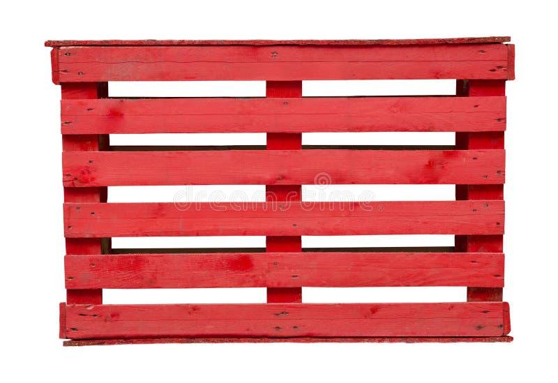 Palette en bois rouge sur le fond blanc images stock
