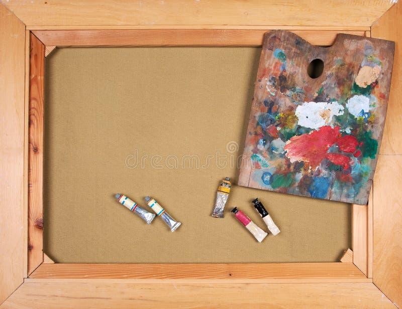 Palette et couleurs sur la toile photographie stock libre de droits