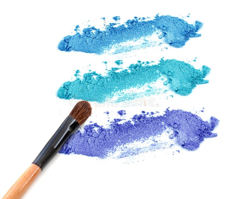 Palette of eye shadows blue tone and make up brush royalty free stock photography