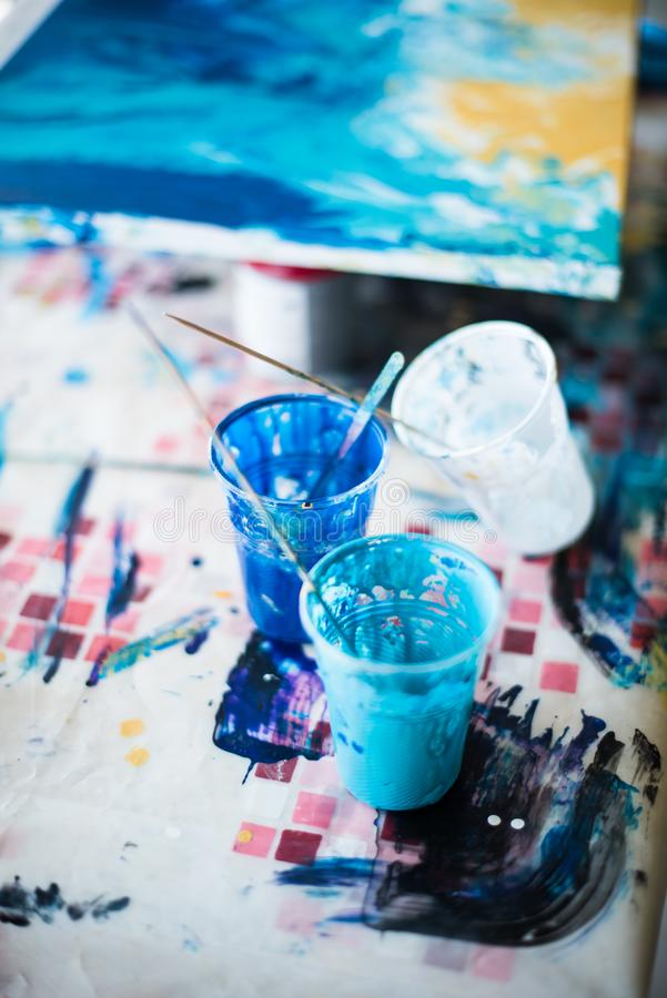 Palette of mixed paints in artist`s studio stock photo