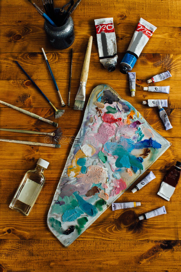 Palette of oil paints stock photos
