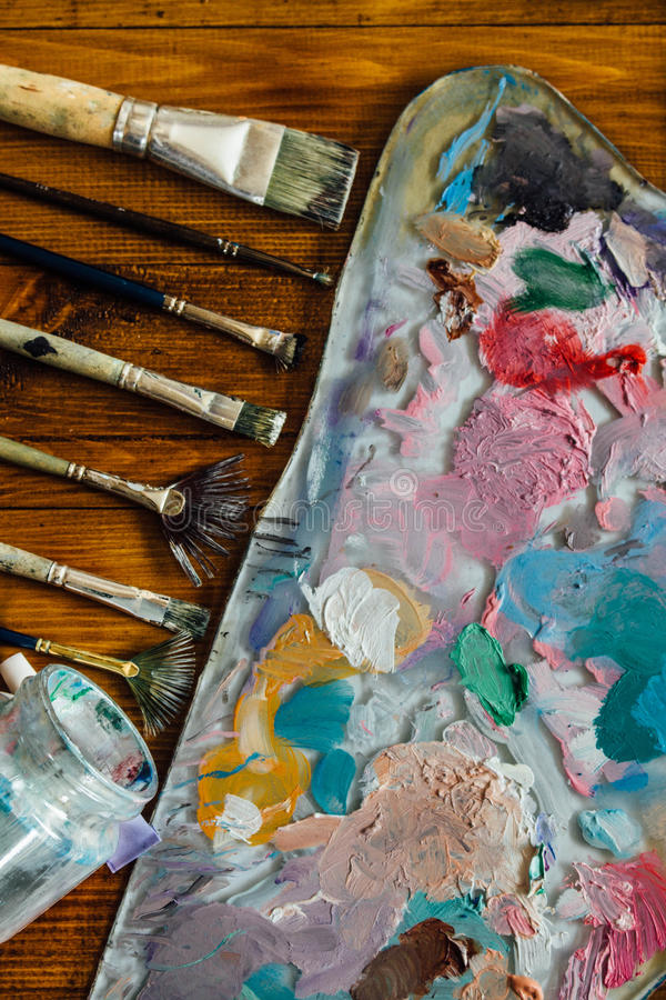 Palette of oil paints stock images