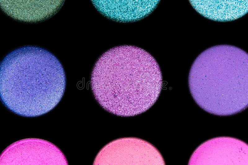Palette with purple and magenta shadows for make up macro on a black background. Palette with purple and magenta shadows for make up close on a black background stock photography
