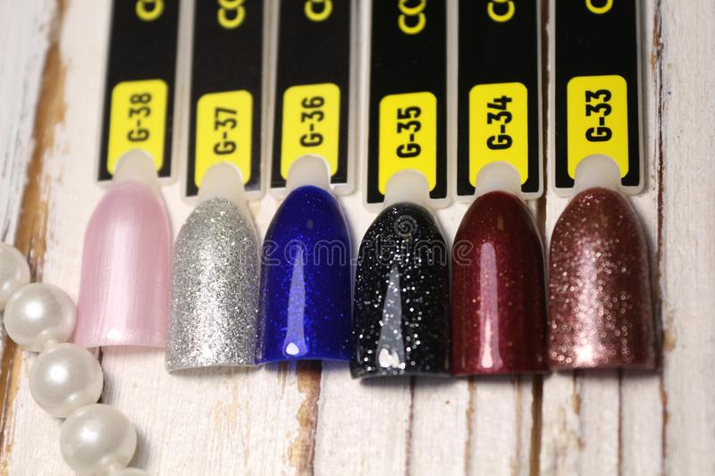 Palette with swatches of nail Polish. a collection of samples of varnish for manicure. Palette with swatches of nail Polish. a collection of samples of varnish royalty free stock photos