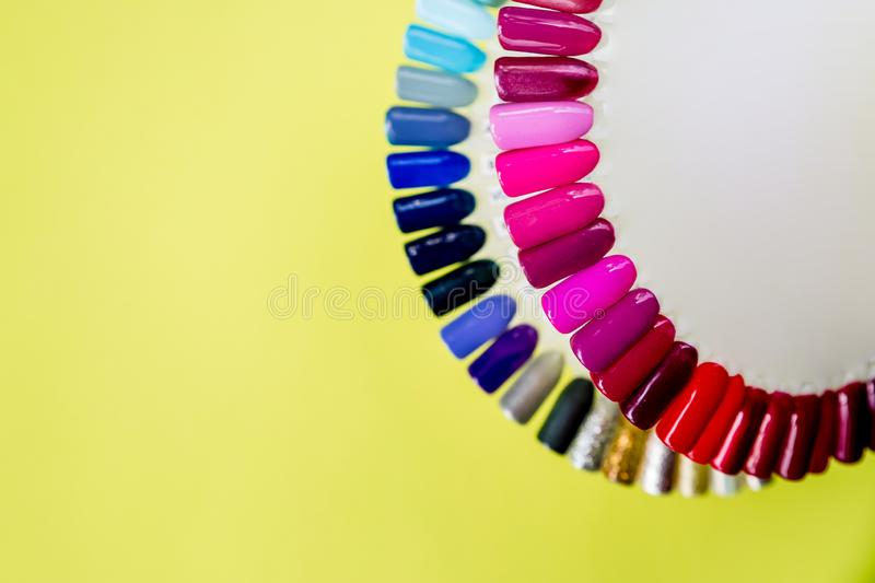 Palette with swatches of nail Polish. a collection of samples of varnish for manicure. trendy colorful various manicure stock photo