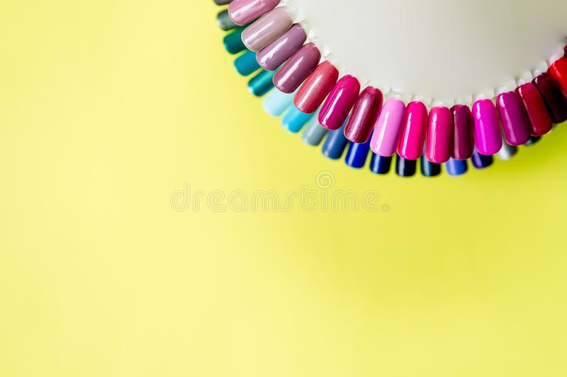Palette with swatches of nail Polish. a collection of samples of varnish for manicure. trendy colorful various manicure royalty free stock photography