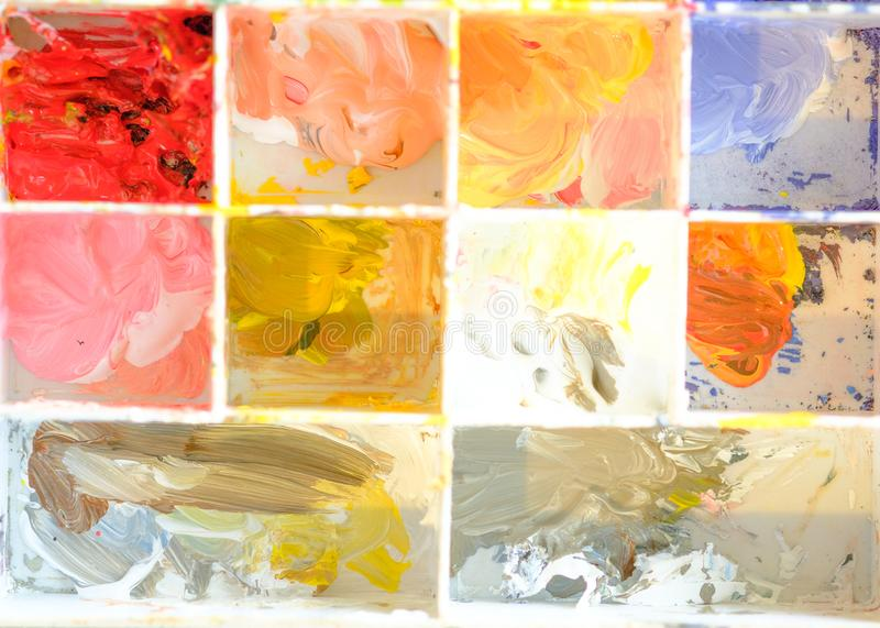 Palette water paints on the table, many color in the palette water paints royalty free stock photo