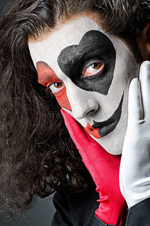 Palhaço com máscara protectora fotografia de stock