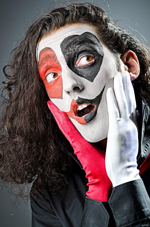 Palhaço com máscara protectora imagem de stock