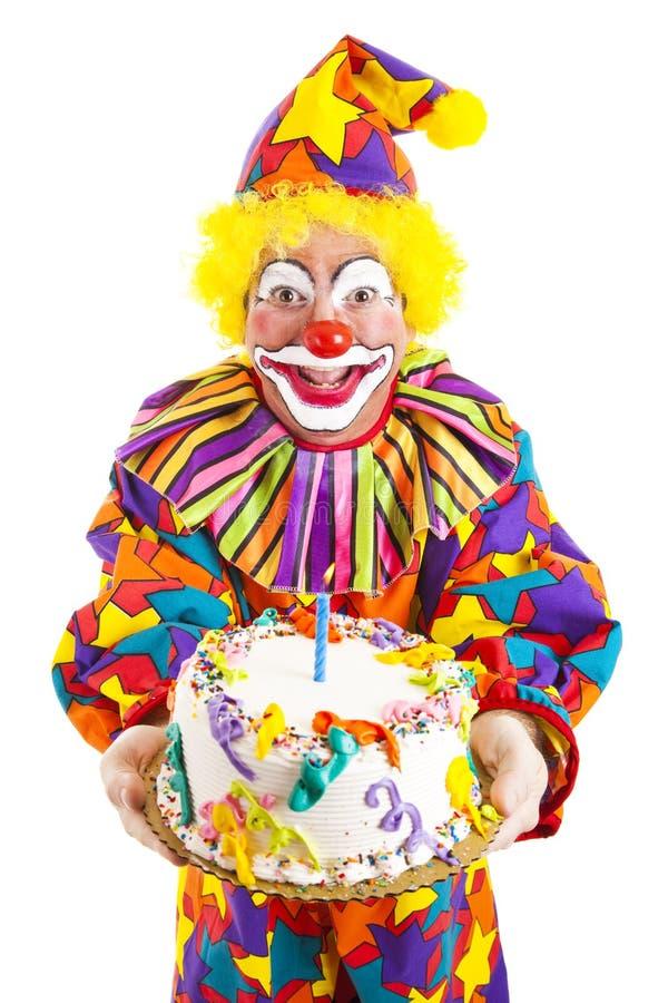 Palhaço do aniversário com bolo foto de stock royalty free
