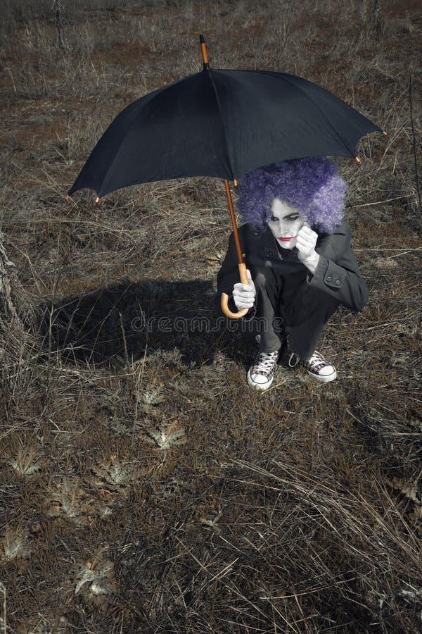 Palhaço e guarda-chuva imagens de stock royalty free