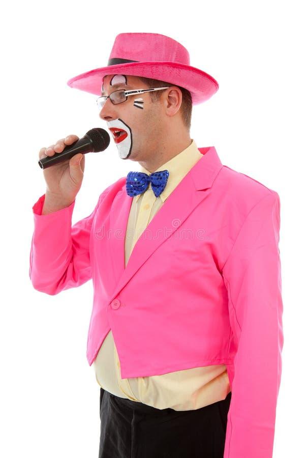 Palhaço masculino como o ringmaster na cor-de-rosa fotografia de stock