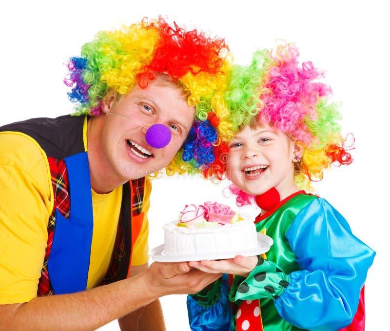 Palhaços com um bolo fotos de stock royalty free