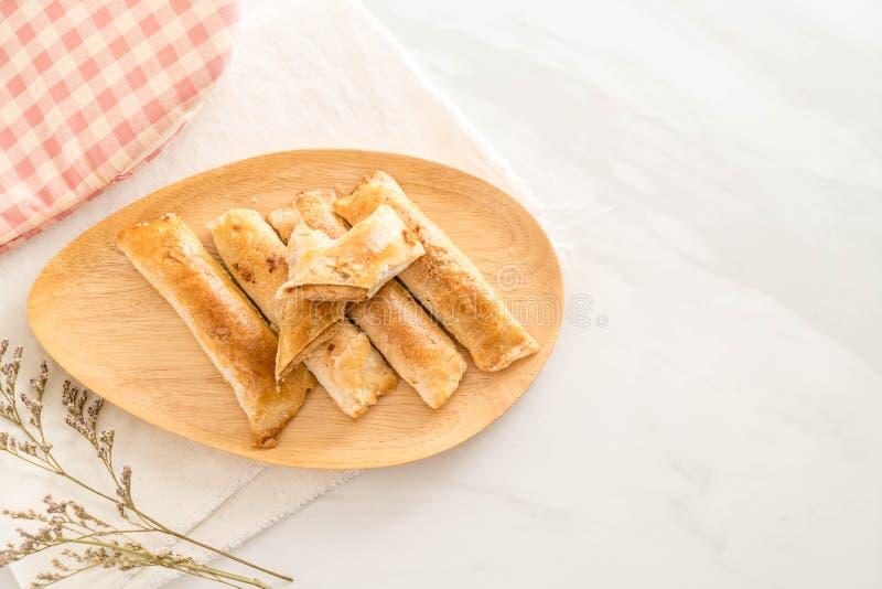 palillo de las empanadas con cerdo destrozado secado fotografía de archivo