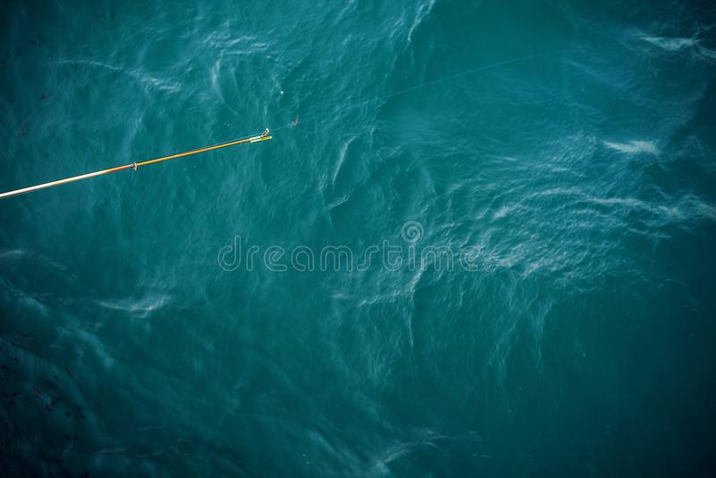 Download Palillo De Pesca Por Encima De La Superficie Foto de archivo - Imagen de simple, pesca: 100526966