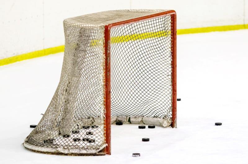 Palillo del hockey sobre hielo con el duende malicioso foto de archivo libre de regalías