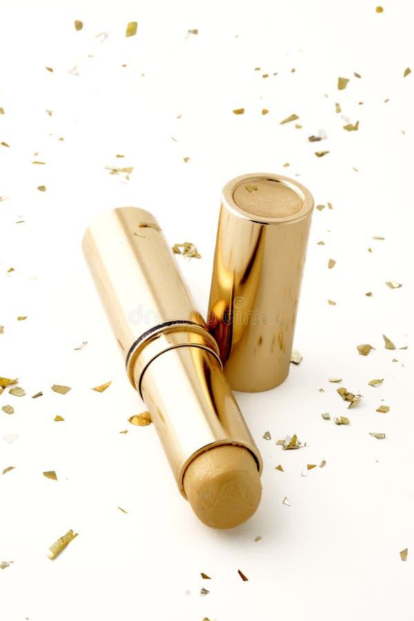 Palillo del maquillaje del oro fotos de archivo