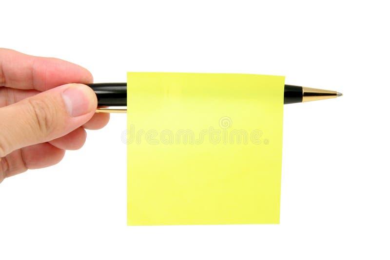 Palillo en blanco del papel de carta en una pluma foto de archivo