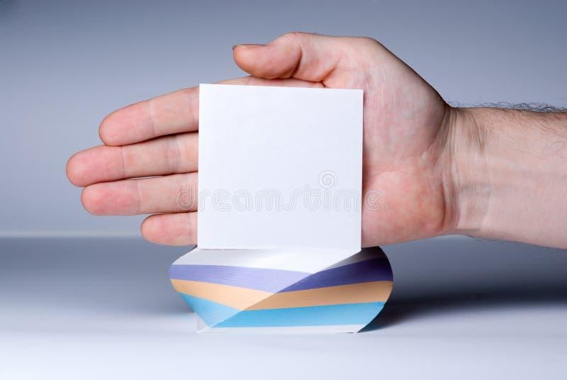 Palillo en blanco del papel de carta a mano imagenes de archivo