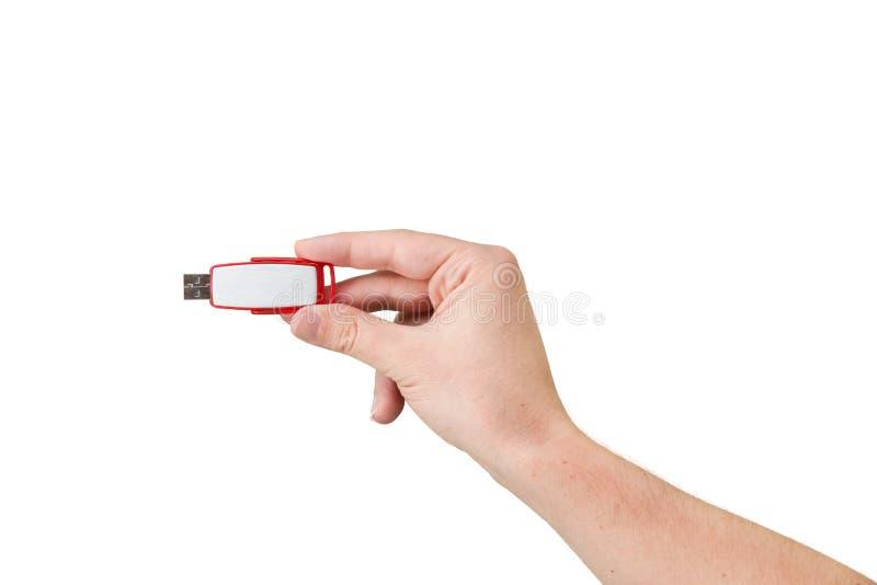 Palillo rojo de memoria USB a mano con el fondo blanco imagen de archivo libre de regalías