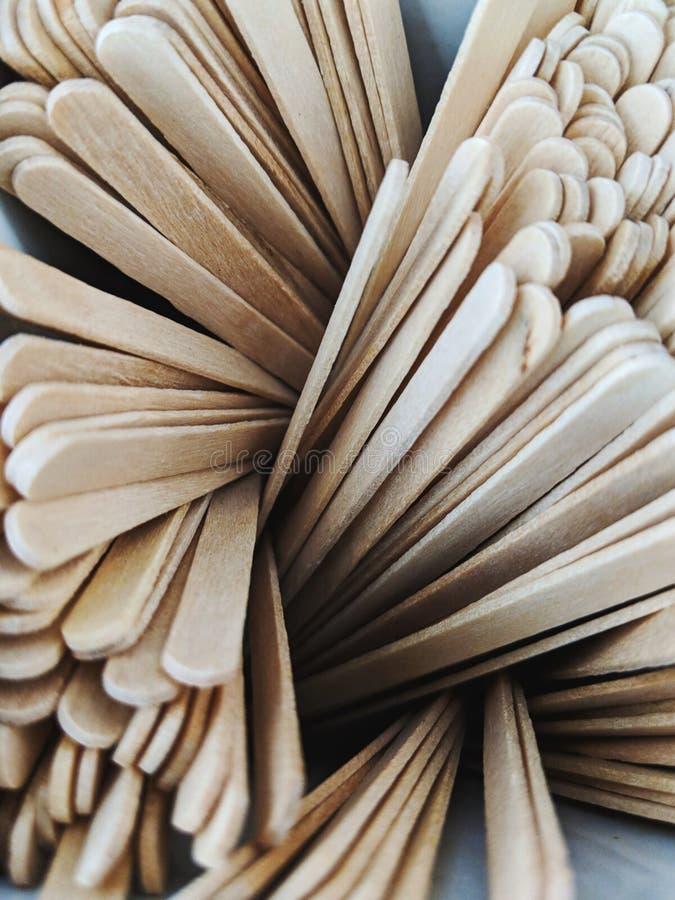 Palillos de madera de la agitación en un remolino imagen de archivo libre de regalías