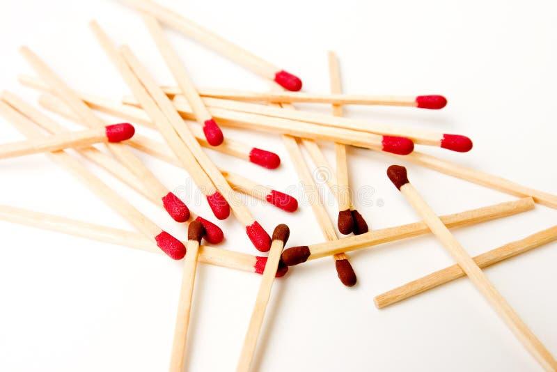 Palillos del partido del rojo y del marrón foto de archivo