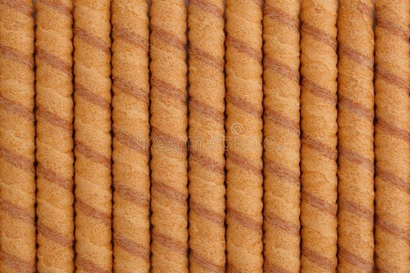 Palillos del rollo de la oblea como fondo, visión desde arriba fotos de archivo