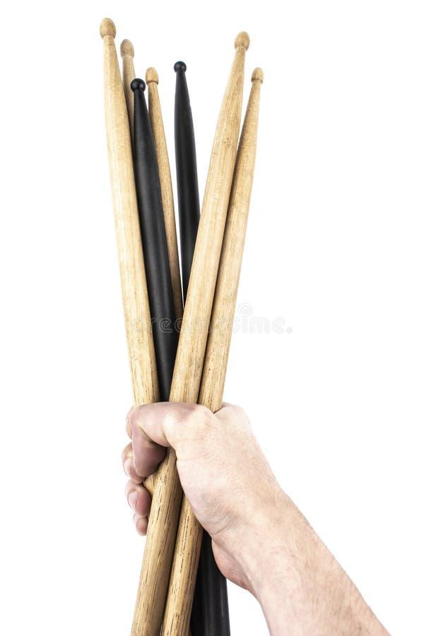 Palillos del tambor a disposición aislados en el fondo blanco fotos de archivo