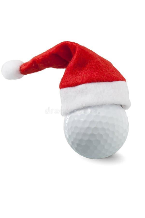 Palla da golf con il cappello di Santa immagine stock libera da diritti