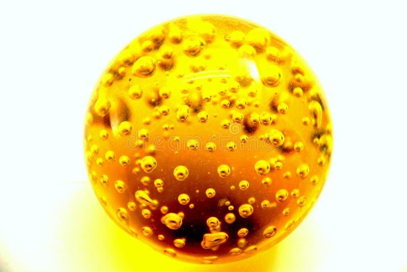 Palla dell'olio dell'oro giallo immagini stock