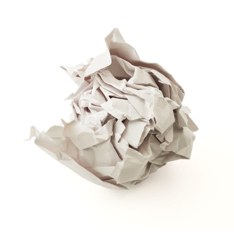 Palla di carta grigia sgualcita sopra fondo bianco fotografie stock