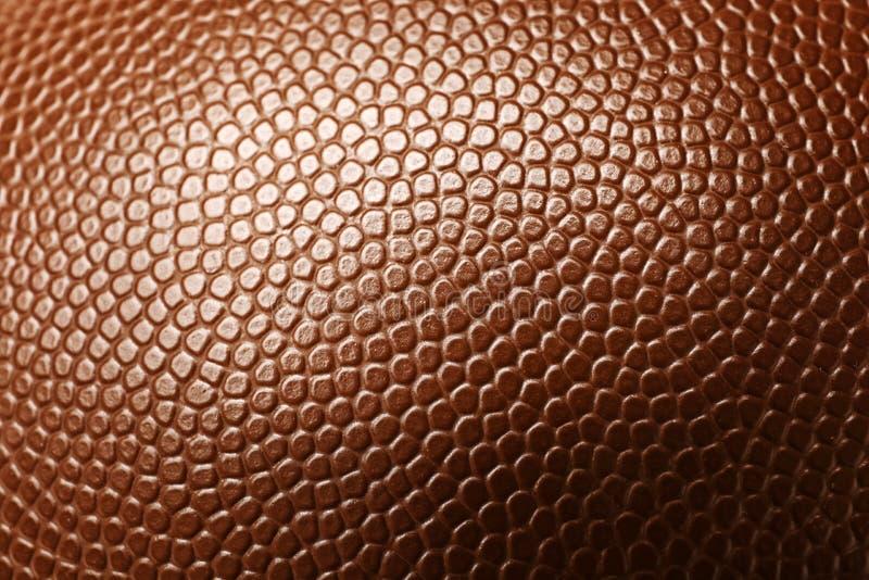 Palla di cuoio di football americano come fondo fotografie stock