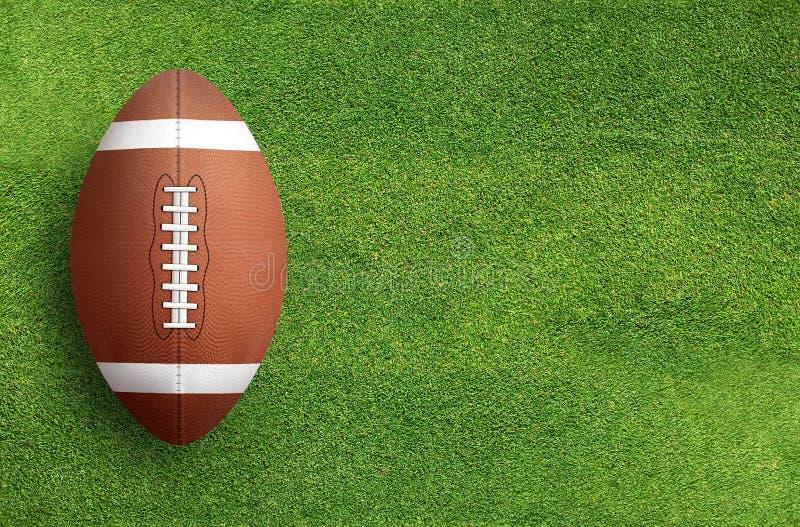 Palla di football americano sul fondo del campo di erba fotografia stock