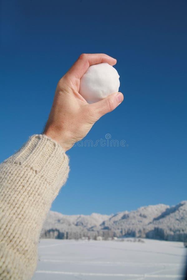 Palla di neve a disposizione immagine stock