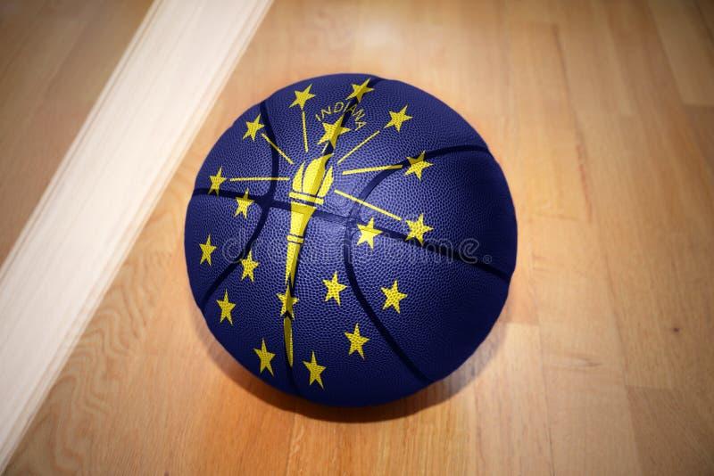 Palla di pallacanestro con la bandiera dello stato dell'Indiana immagine stock