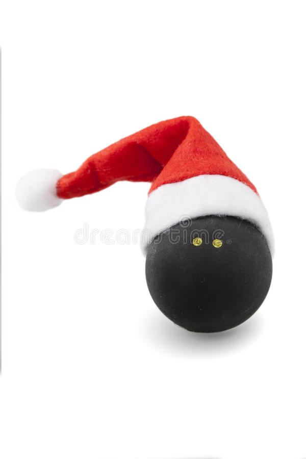 Palla di zucca con il cappello di Santa immagine stock