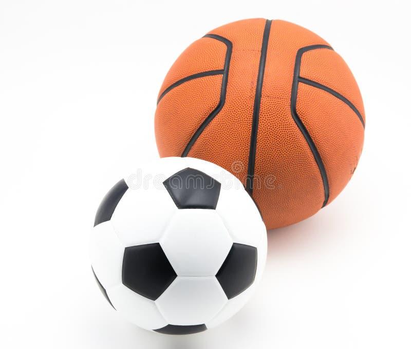 Pallacanestro e pallone da calcio immagine stock libera da diritti