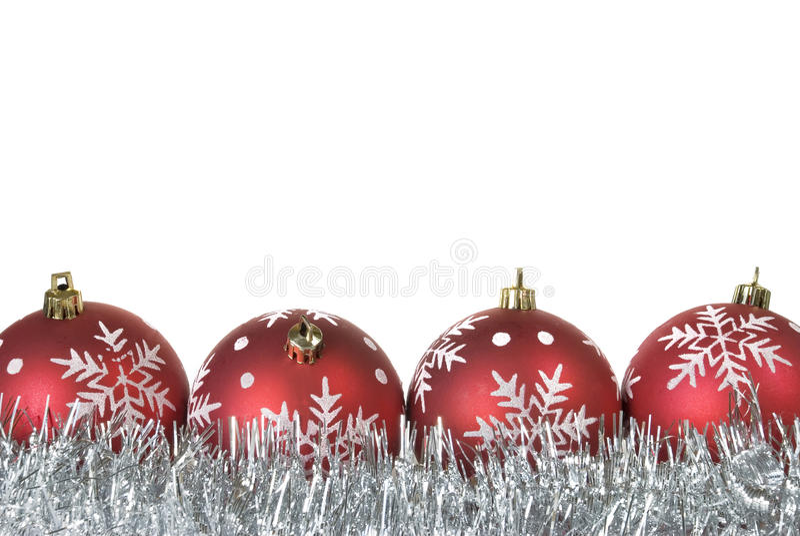 Palle di Natale con i fiocchi di neve su lamé fotografia stock