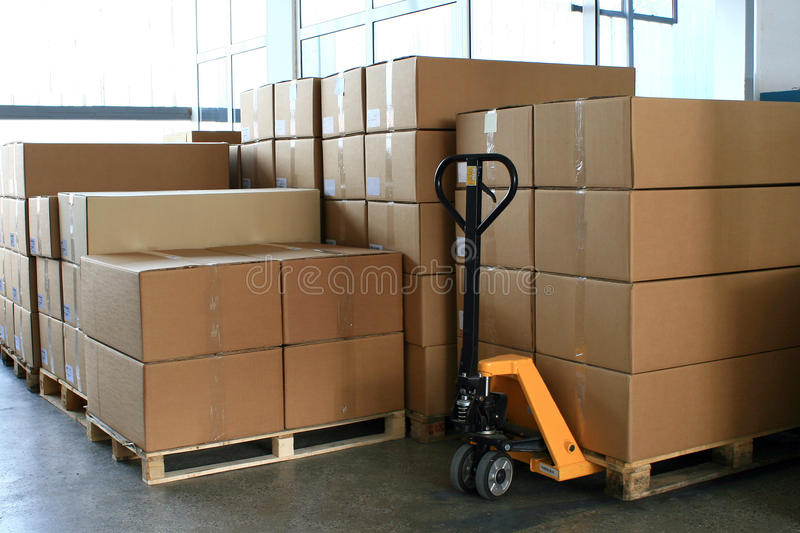 Pallet changer fork truck into store stock images