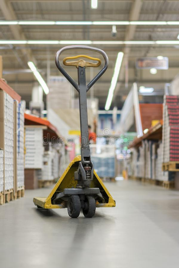 pallet jack in a building store. Manual pallet jack in supermarket royalty free stock image