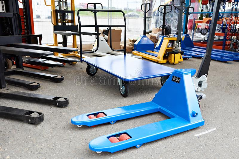 Pallet jacks in store stock images