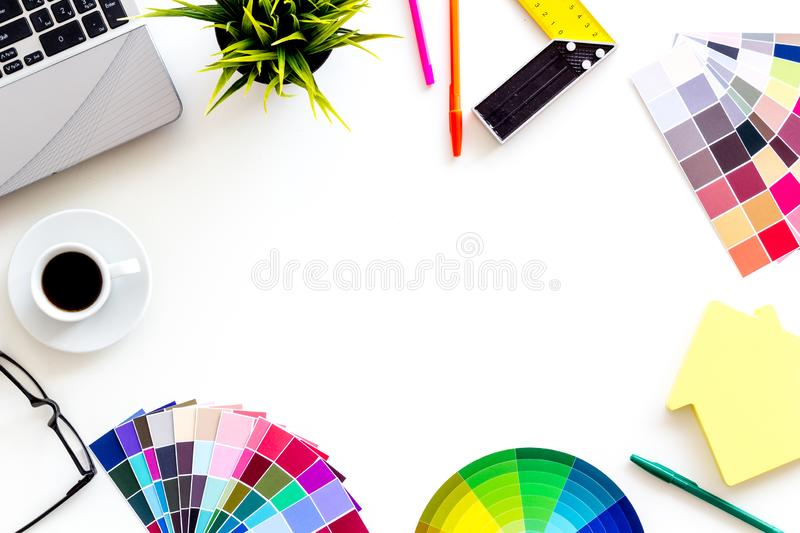 Pallet, laptop, house figure, coffee and tools for architect work on white desk background top view copyspace frame stock photography