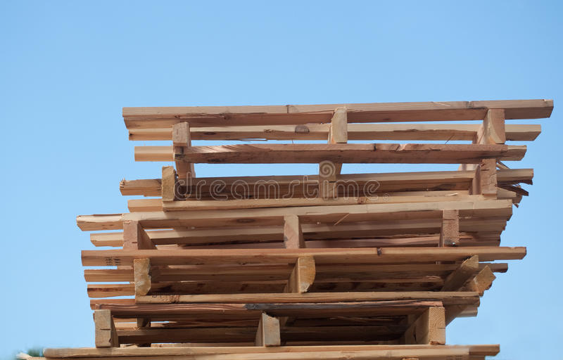 Pallets. Stack of wood pallets, stacked to the sky royalty free stock images