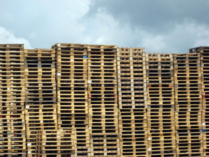 Pallets against cloudy sky royalty free stock photos